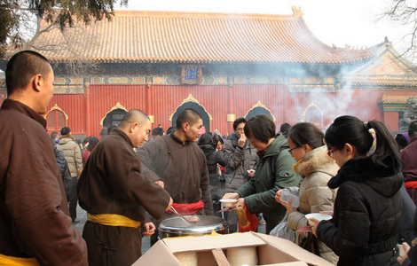 monks serving free laba porridge