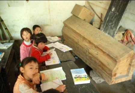 Coffin stored in classroom of rural primary school.
