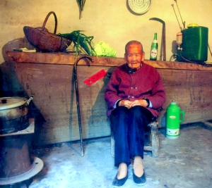 89yr old Hunan woman has her coffin ready in her kitchen.