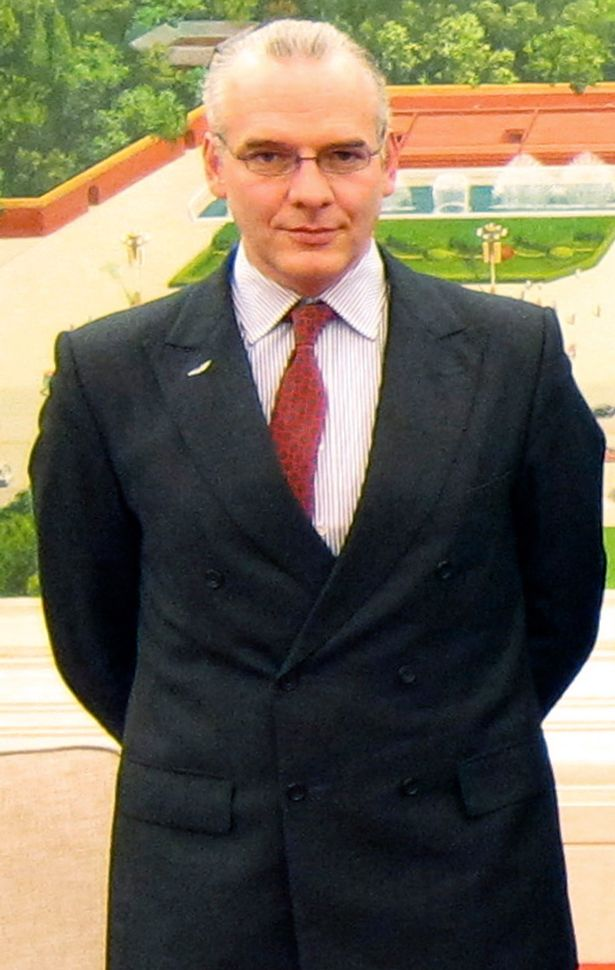 British businessman Neil Heywood is seen in this undated photo taken at the Great Hall of the People in Beijing.jpg