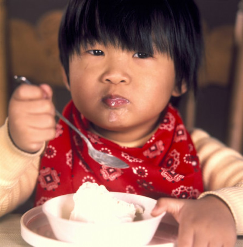 Chinese kid eating icecream.jpg